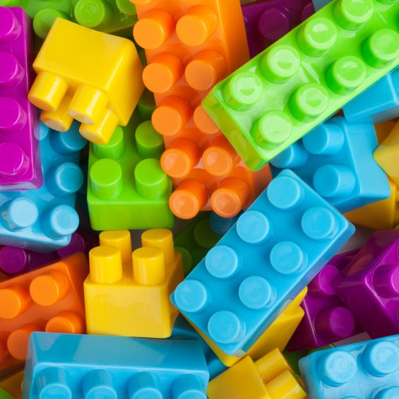 This is an overhead photo of colorful building blocks. These are generic building blocks. They are not legos.