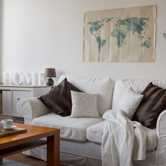 Image of comfortable white double sofa in day room